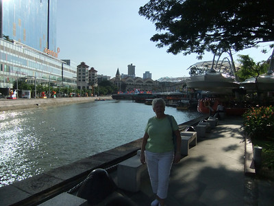 One more shot walking along the Singapore River!   Those 2 octagon towers on the left are Mom's hotel for the next 9 days  Tomorrow:  DuckTours, Cable Cars, and Theatre Tickets!