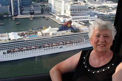 Mom looking down on the top deck of the cruise ship!