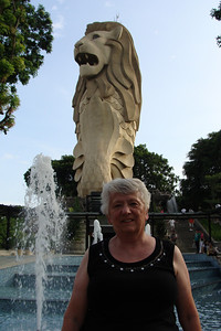 """Mom on Sentosa Island - standing in from of the """"other"""" Singapore Merlion!  Tomorrow - a relaxing day for Mom (hotel, spa, pool, etc)....and a long work day for Dan  Friday - we're off to the Singapore Botanical Gardens!"""