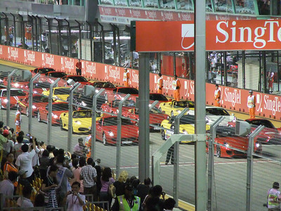 Between qualifying rounds - the Singapore Ferrari Club got to drive their cars around the track 3 times.  I guess if you spend S$1 million for a car - you SHOULD get to do this