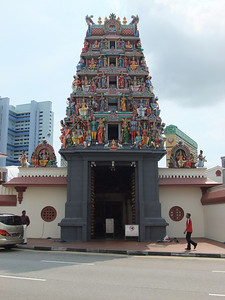 One of those Hindu temples scattered all over Singapore.  You can tell because they are always covered with statues of blue people and cows....oh, and there are alot of shoes outside