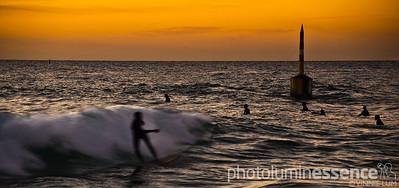 Sunset surfers at Cottesloe Beach, Perth, Australia.