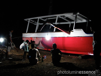 Locals working on a boat late into the night, Gili Air, Indonesia.