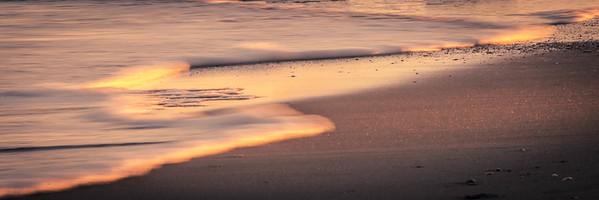 Sunlight Skimming Edge of the Tide