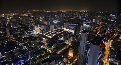 View from 1-Altitude rooftop bar towards west. The bar is 282 meters above sea level, at One Raffles Place, Singapore.