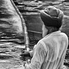 Sikh man cleaning the holy pool