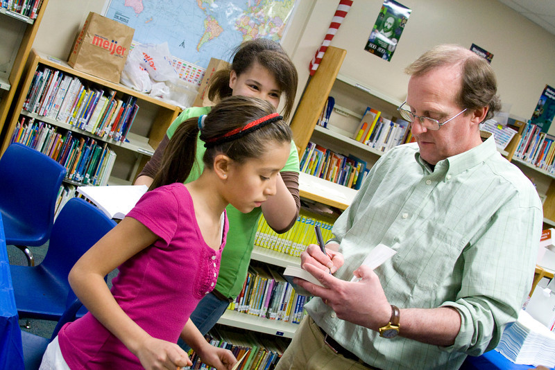 Knapp Charter Academy. Gary Schmidt signs books.