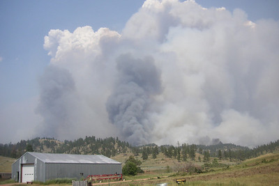 This photo was taken from Jackie Musgrove's home on July 1, 2012. The grassy areas on the far hilltops were opened by logging on private land. The fire burned through the grass there but left the trees largely untouched. (Jackie Musgrove photo)