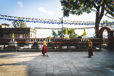 Young monks playing football