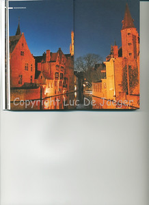 This view on the Belfry (Belfort), seen from the famous Rozenhoedkaai in Bruges (Brugge) is published on the pages 26-27 of the 2009 edition of the CityZine Guide of Bruges.