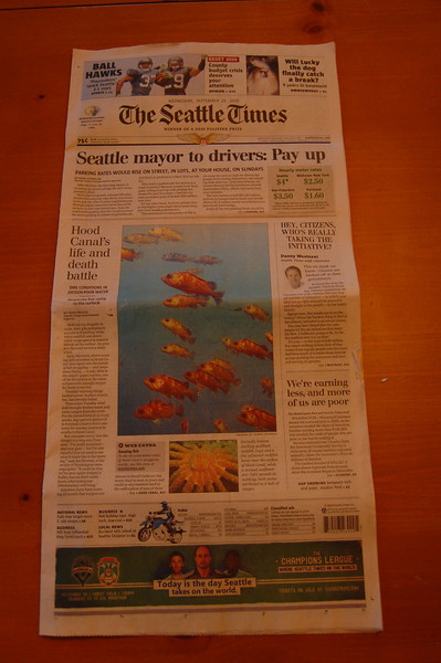 The fish photo and the sunflower star are mine! Front page of the Seattle Times!
