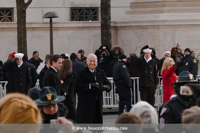 A warm smile by VP Biden to the crowd as he fixed his coat to protect him from the wintry cold weather (felt like 10 degrees)... and Jill at the far right waving at the crowd.