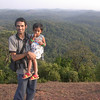 CEPF grantee Balu Hegde holds his daughter in front of Aghanashini Valley, near his farm in Uttara Kannada District, southern India. Mr. Hedge succeeded in getting three conservation reserves established with help from a CEPF small grant. © Conservation International / Photo by Jack Tordoff.