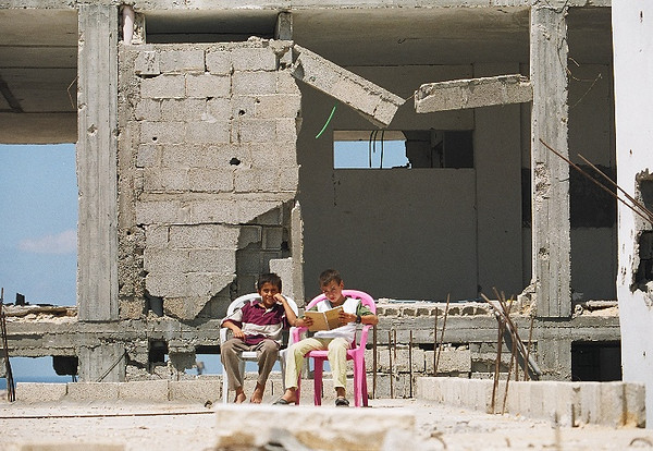 Two school boys sit outside of their bombed home in Rafah, Gaza located in the most souther area of the Gaza Strip near the Egyptian border.