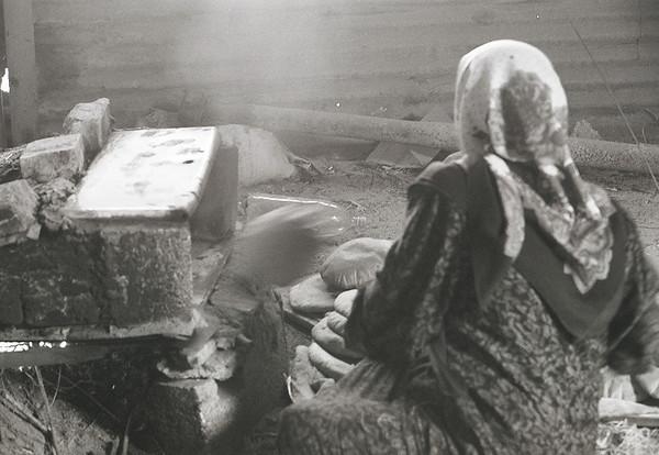 A Negev Bedouin women cooks bread. Israel