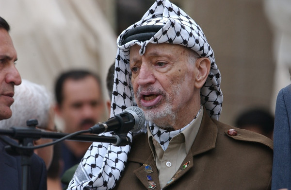 Yassar Arafat gives a talk to the media and Palestinians in Ramallah in front of his compound that he was confined to by the Israelis.