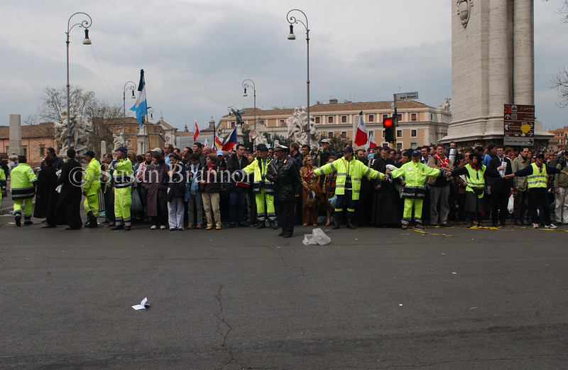 Italian Police hold back the crowd to view Pope John Paul II after the announcement of his death.