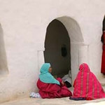 Tunisia women sitting outside of their homes during the beginning of the Arab Spring.