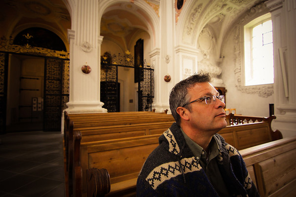 Thoughtful takes in the Jesuit Church in Lucerne, Switzerland.