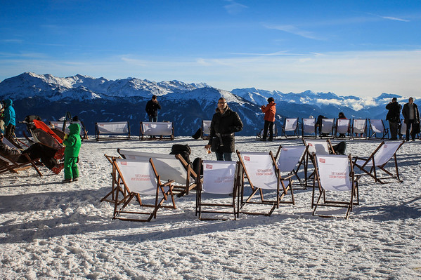 Lounge chairs positioned between the cafe and igloo bar at Seegrube ski station overlooking Innsbruck, Austria.