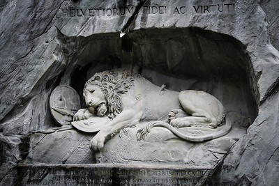 """The inscription reads, """"To the loyalty and bravery of the Swiss""""."""