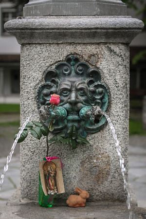 Lion at the base of a fountain near the Franciscan Church in Lucerne, Switzerland.