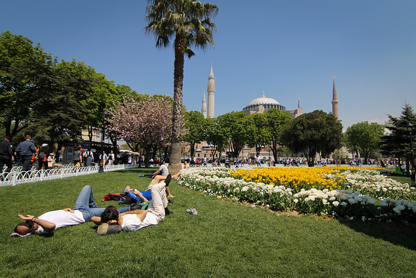 Resting in the green grass of the gardens between the Hagia Sophia and the Blue Mosque in Istanbul