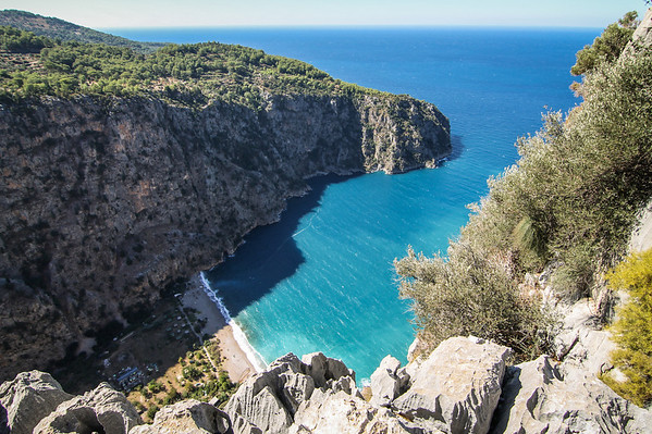 Overlooking Butterfly Valley in Ölüdeniz, Fethiye. Boats bring tourists to relax on the hidden beach for the day.