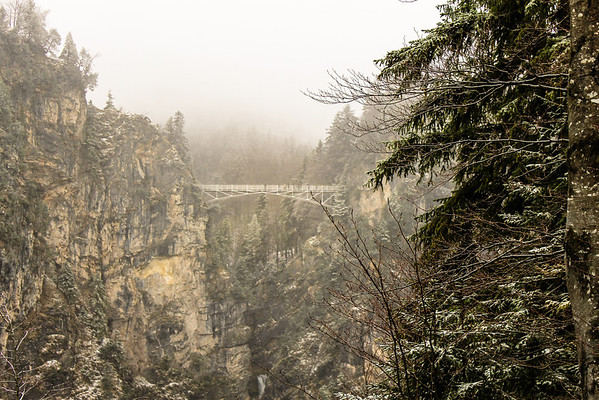 Marie's Bridge barely visible in the snow while visiting Neuschwanstein Castle if Fussen, Germany, near Munich.