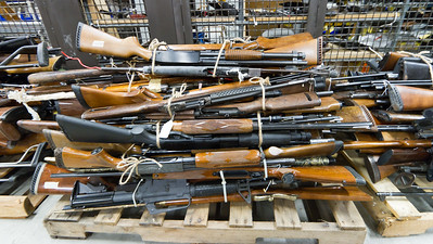 Guns confiscated by the Los Angeles Police Department sit in a secure storage locker.