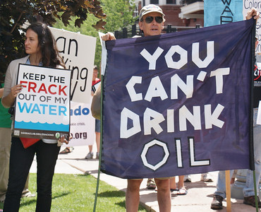 Fracking opponents demonstrate at the Democratic Governor's Conference in Aspen Colorado (7/13/13).