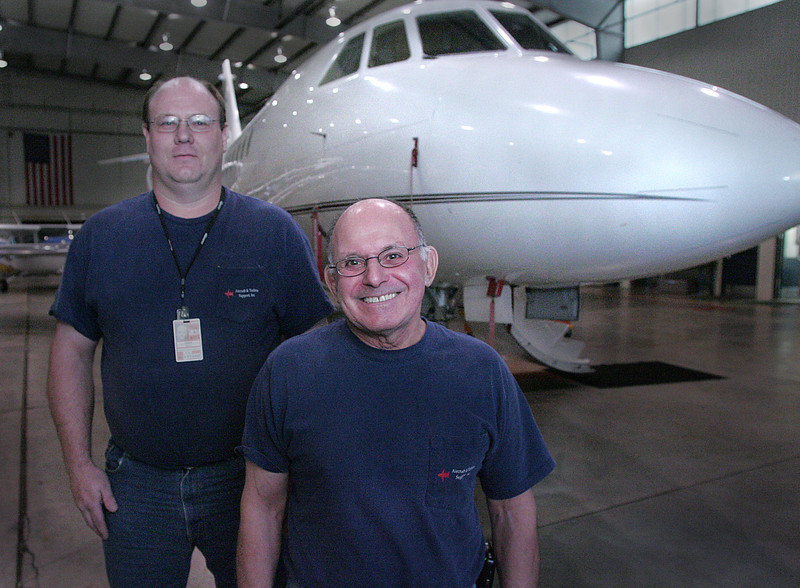 Joe Cole and John Heiser Co-Owners of Aircraft & Turbine Support, stand for a photo in their hanger at Tulsa International Airport.  Their business is set to break grown on a second hanger.