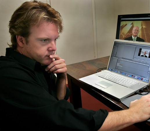 Brant Fricker of Rollins Communications works on a video internet advertisement Friday morning in Tulsa.
