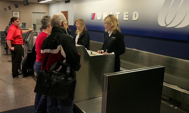 Sharon Baldridge and Deb Williams help customers at the united Airlines ticket counter at Tulsa International Tuesday.  The carrier will soon be offering non-stop flights to Los Angeles from Tulsa.