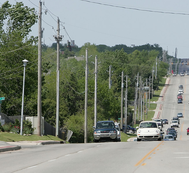 Utility poles line South Tulsa streets.