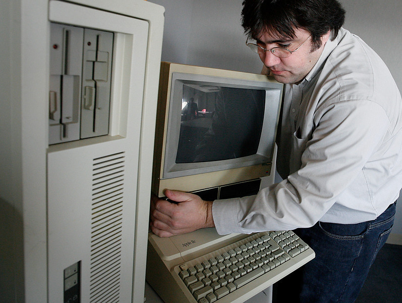 Gavin Manes, Owner of Avansic Digital Forensics in Tulsa, assembles some older model computers at their company offices in downtown.
