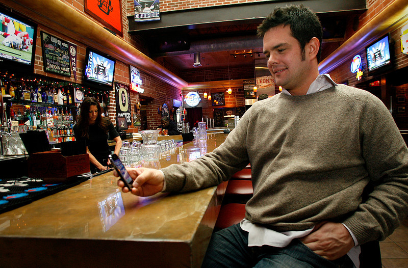 Owner of Leonís Restaurant in Tulsa J.L Lewis uses an application developed for the I-phone to inform customers of specials the restaurant is running.