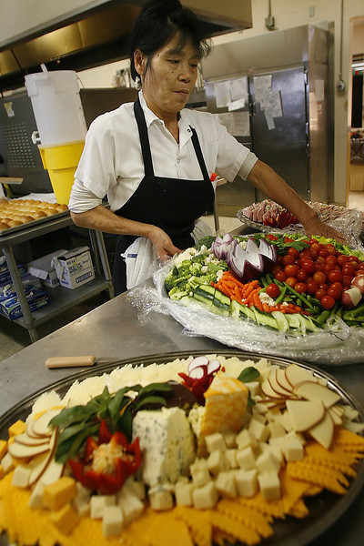 Party trays for a Christmas party are prepared by Catering Connection chef Suki Hernandez in Tulsa