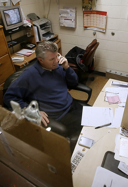 Quentin Turner, Owner of the Catering Connection, works the phone taking orders during the busy Christmas season.