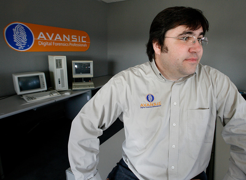 Gavin Manes, Owner of Avansic Digital Forensics in Tulsa, with some older model computers at their company offices in downtown.