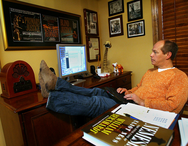 Writer William Bernhardt works at his home office in South Tulsa.