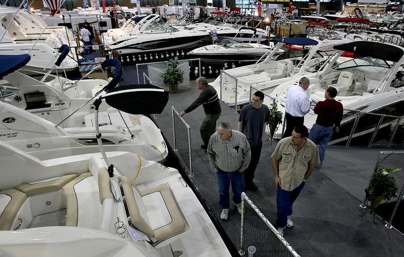 Customers look over boats on display at last weeks Tulsa Boat Show.