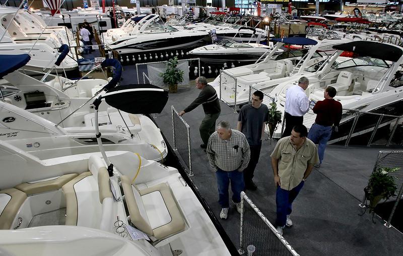 Customers look over boats on display at last weeks Tulsa Boat Show.