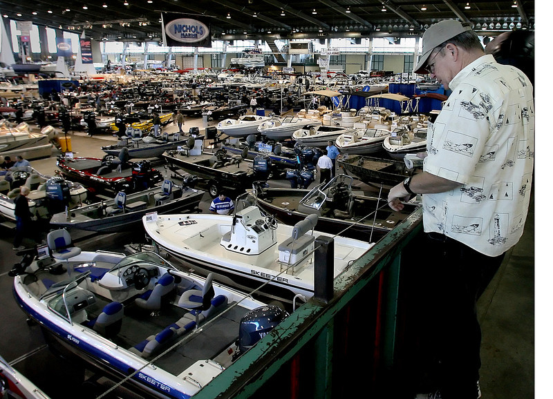 Mickey Wynn looks over the boats on display at the Tulsa Boat Show.