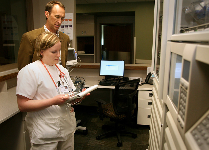 Mark Roberts, CEO of the Muskogee Community Hospital and Nurse Shelly Heimbach check software used to dispense correct medications to patients.