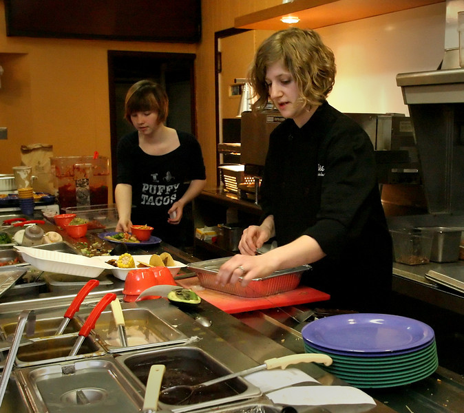 Libby Auld, Owner of Eloteí Restaurant in Downtown Tulsa, prepares a lunchtime catering job.