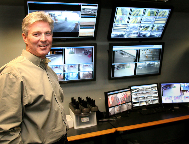 Scott Glanz, Director of Operations for Fine Airports Parking, at the control room used to direct security cameras and record the different views of the facility.
