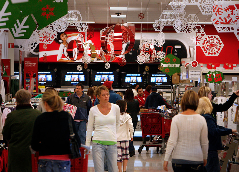 On Black Friday shoppers wander the isles of a South Tulsa Target store.