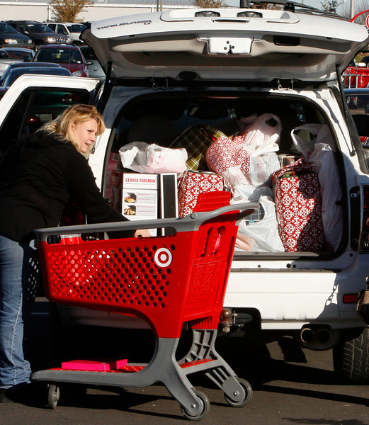 On Black Friday in Tulsa shopper Katie Garcia loads her SUV with Christmas presents.
