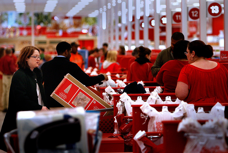 On Black Friday a shopper stands in the Target checkout line as her purchases are tallied during Black Friday.